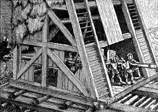 осадная башня, в основании которой установлен таран